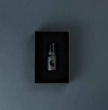 Bottle of opened Spanish Fly PRO product on grey background