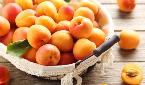 The full basket of apricots which could be considered as an aphrodisiac
