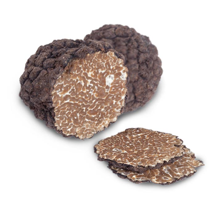 a two truffles on white background, one is cut